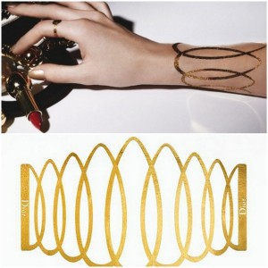 Gold tattoo by Dior